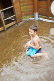 Little boy in a puddle Stock Photo
