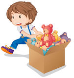 Little boy pulling box of teddy bears Stock Images