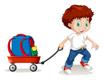 Little boy pulling cart with backpack on it Royalty Free Stock Images
