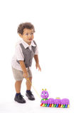 Little boy pulling his toy Stock Photography