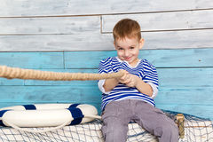 Little boy pulling a rope royalty free stock photo