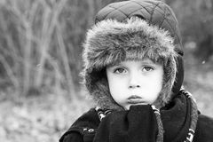 Little boy pulling sad expression Royalty Free Stock Photos