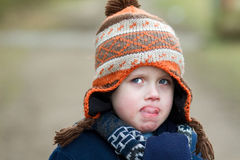 little boy pulling sad expression Stock Photos