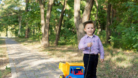 Little boy pulling a toy truck Royalty Free Stock Images