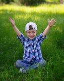 Little boy pulls hands upwards Stock Photography