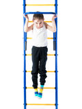 Little boy pulls up on the sports Horizontal bars Stock Photo