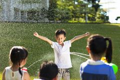 Little boy Punishment for water gun spray to wet body. In the park Stock Photography