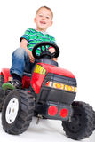 Little boy pushes the tractor Stock Photos