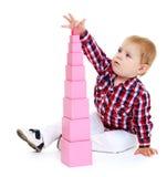 Little boy puts cubes. Stock Images