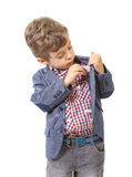 Little boy puts money in his pocket Stock Photography