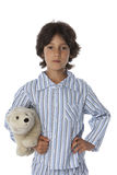 Little boy in pyjamas. Ready for bed, on white background Stock Photo