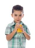 Little Boy que bebe un vidrio de jugo Imagen de archivo libre de regalías