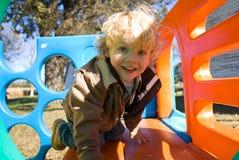 Little Boy que juega en diapositiva Imagen de archivo libre de regalías