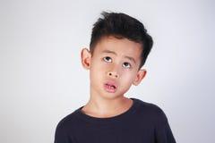 Little Boy que piensa algo Imágenes de archivo libres de regalías