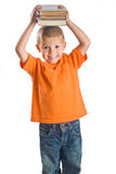 Little Boy que sostiene los libros Imagen de archivo