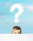 Little boy with a question mark above head Stock Photography