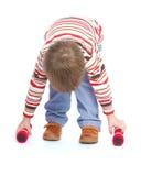 Little boy raises his arms dumbbells Stock Photos