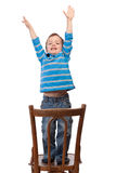 Little boy raises his arms up Royalty Free Stock Photo