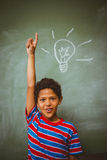 Little boy raising hand in classroom. Portrait of cute little boy raising hand in classroom Stock Image