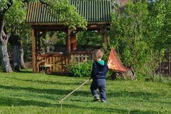 Little boy with a rake Royalty Free Stock Photo