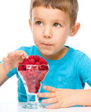 Little boy with raspberries Royalty Free Stock Image
