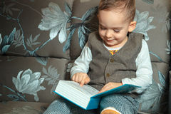 Little boy read a book Royalty Free Stock Photography