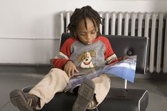 Little boy reading Stock Image