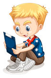 Little boy reading from the board Royalty Free Stock Photos