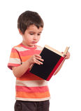 Little boy reading book Royalty Free Stock Photos
