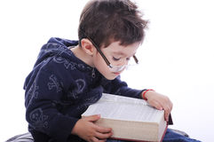 Little boy reading a book Royalty Free Stock Photos