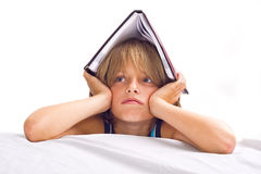 Little boy reading book Stock Images
