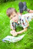Little boy reading book Stock Image