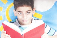 Boy reading at home royalty free stock photo