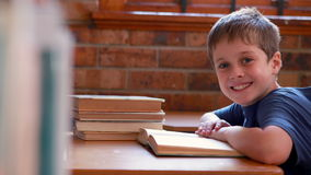 Little boy reading book in classroom Royalty Free Stock Photo