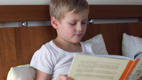 Little boy reading book stock video footage