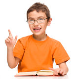 Little boy is reading a book Stock Image