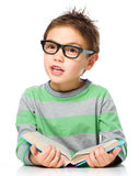Little boy is reading a book Royalty Free Stock Photos