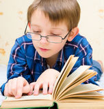 Little boy is reading a book. At home Royalty Free Stock Photo