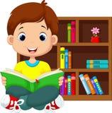 Little boy reading a book Stock Photos