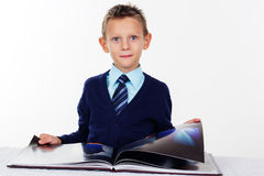 Little boy is reading a book, isolated on white Royalty Free Stock Photos