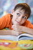 Little boy reading a book Stock Images