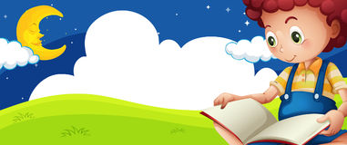 Little boy reading book at night Stock Photo