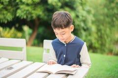 Little boy reading book Royalty Free Stock Photo