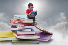 Little boy reading a book Royalty Free Stock Images