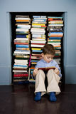 little boy reading book sitting on the floor Stock Photos