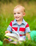 Little boy is reading book Royalty Free Stock Photos