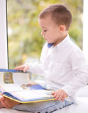 Little boy is reading book Stock Image