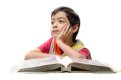Little boy reading a book and think isolate Stock Photos