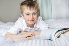 Little boy reading before dream in his bed. A little boy reading before dream in his bed Royalty Free Stock Photo