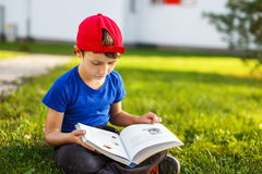 Little boy reading fable book Stock Photos